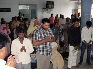 Prayers in the corridor. Patients and relatives of all faiths pray together