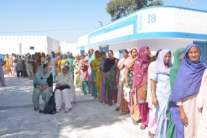 Women wait patiently for their turn in a village treatment clinic