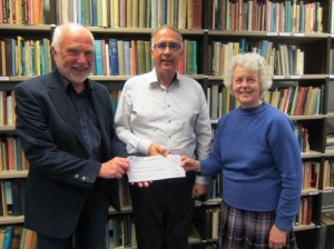 The photograph shows Ursula Hyde handing over her cheque to the Treasurer and Chairman